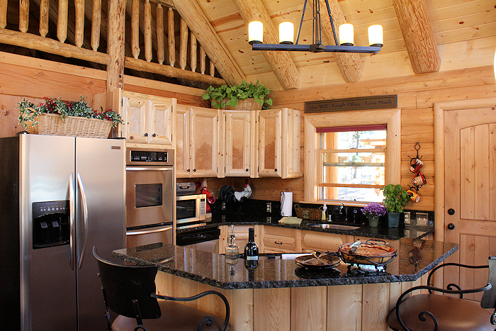 Log home kitchen counter choices real log homes for Log home kitchen designs
