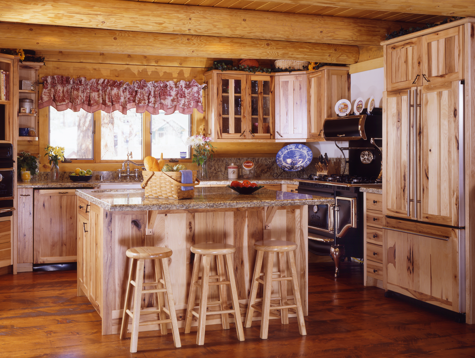 Summer Time and these Log Home Kitchens are Hot