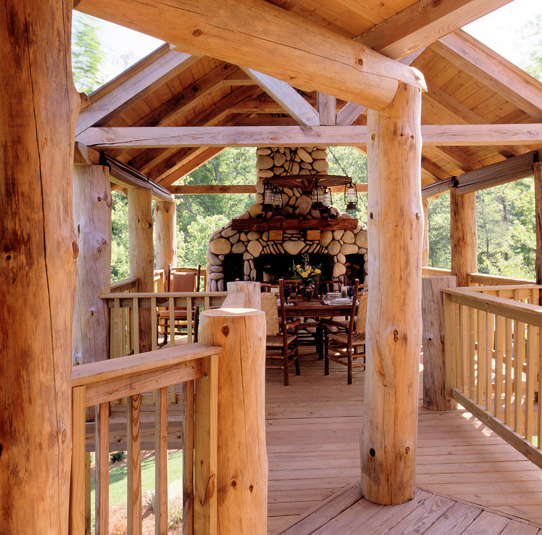 Getting out and enjoying yourself real log homes - Outdoor living spaces with fireplace ...