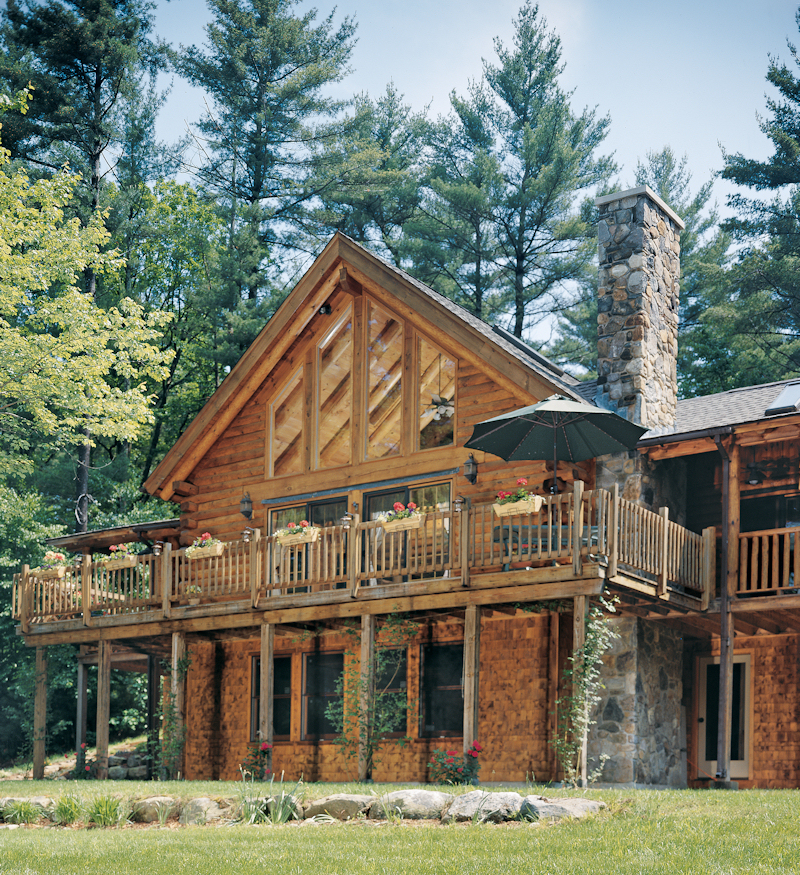 Getting out and enjoying yourself real log style for Full wrap around porch log homes