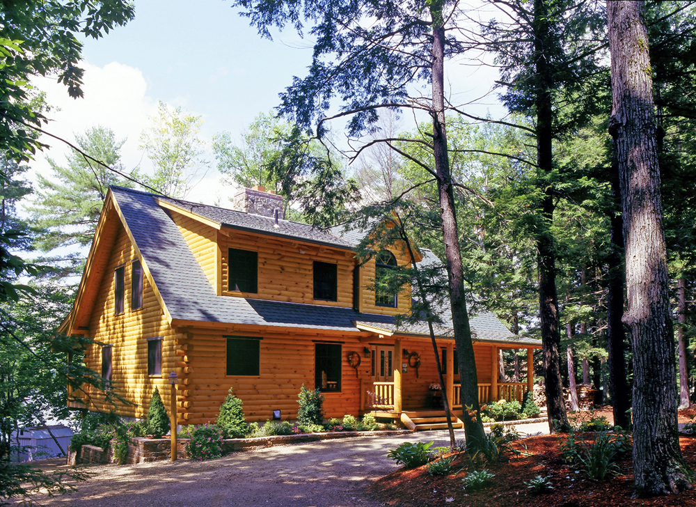 Log Home In the Woods with Dwarf Evergreen Plantings