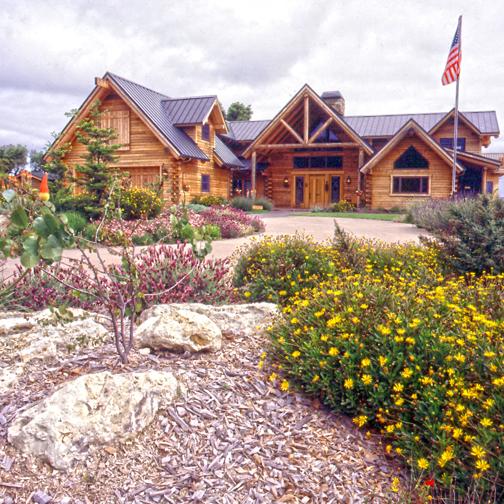 Landscaping for easy log home maintenance real log style for Log cabin maintenance