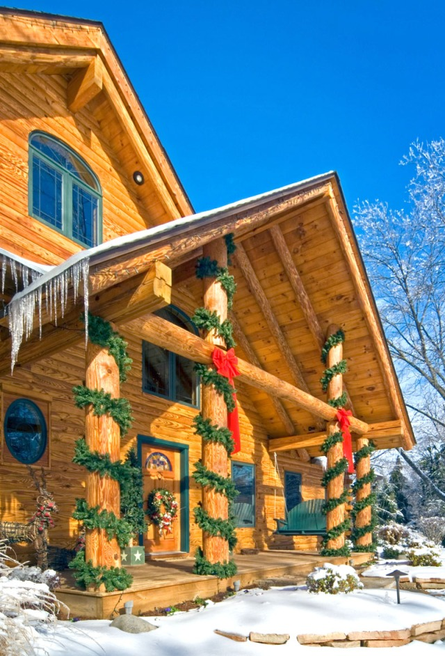 Log Home Porch Decorated For Christmas