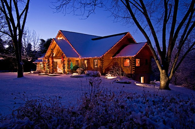 Log Home With Christmas Lights in Snow