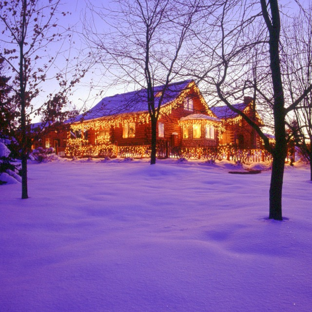 Michigan Log Home With Christmas Lights in Snow
