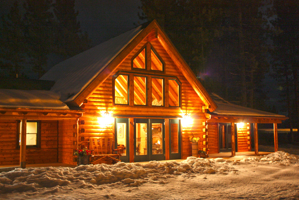 california log home at night in the snow