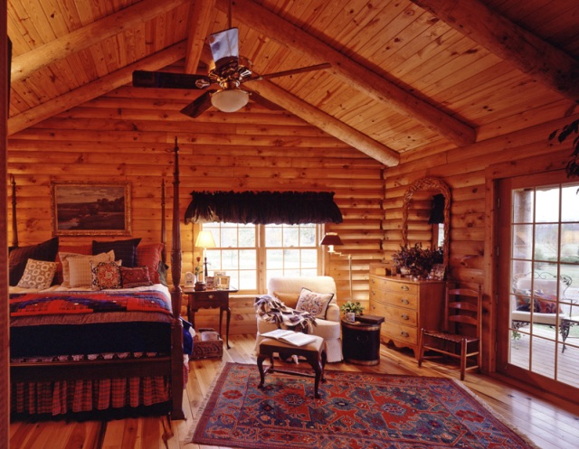 log home bedroom with vaulted ceilings