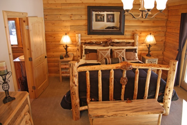 Log Home Bedroom With Rustic Log Bed And Furniture