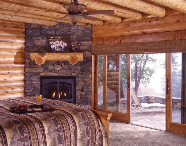 california log home with fireplace and french doors