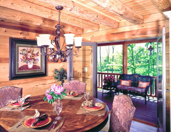 kentucky log home dining room with french doors on to covered porch