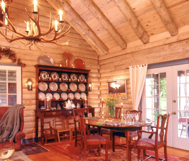 log home dining room with french doors