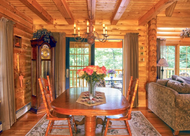 log home dining room with french doors and tabbed curtains