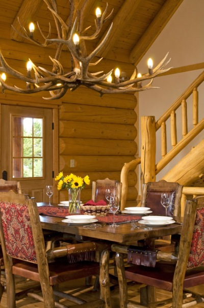 Log home dining room with antler chandelier