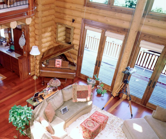 log home great room with double french doors