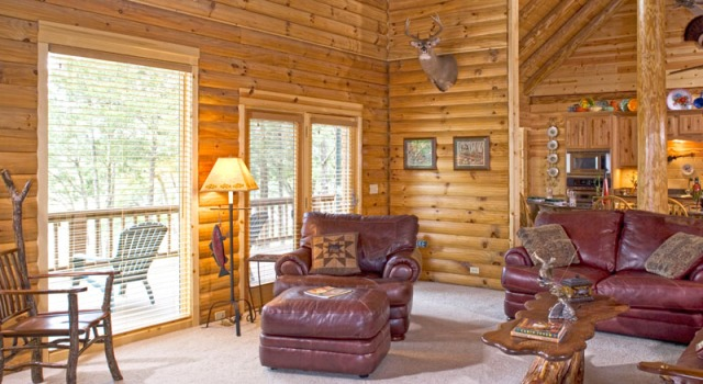 log home great room with sliding glass doors