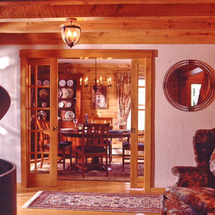 log home dining room with pocket doors