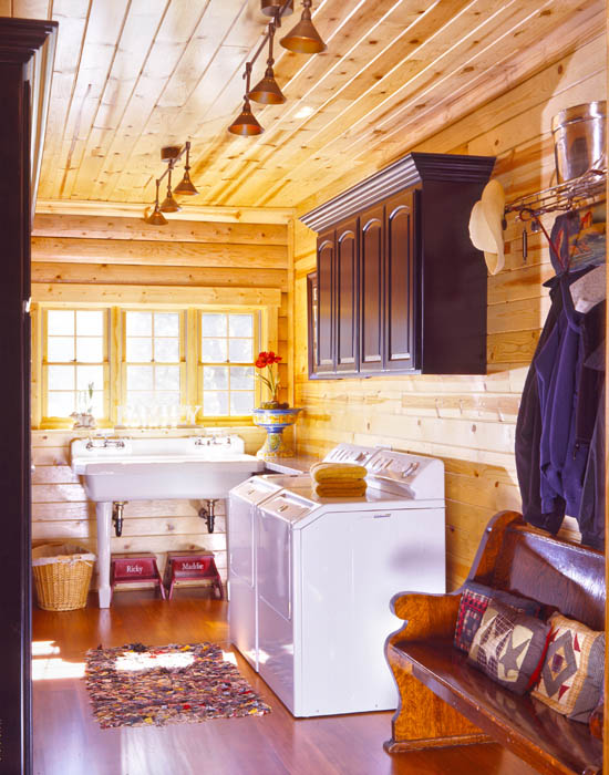 log home laundry room with laundry sink and sunny windows