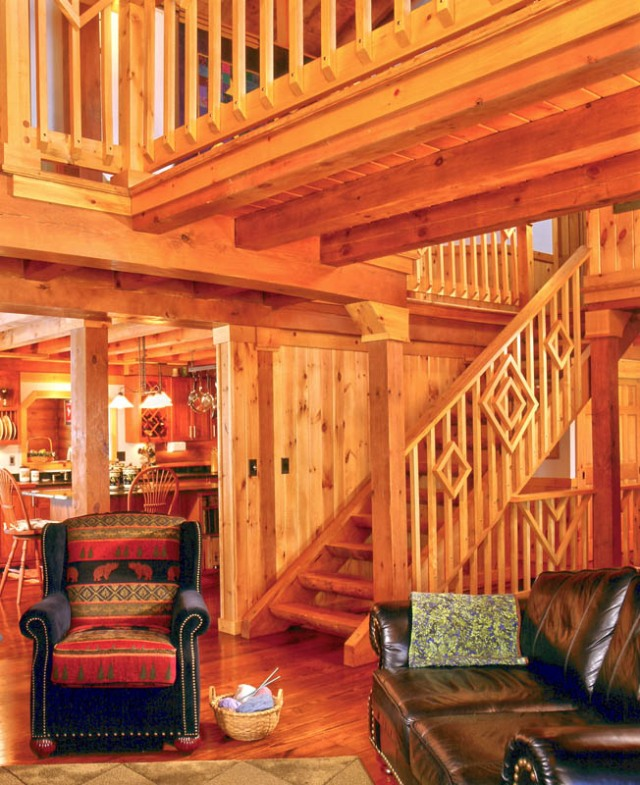straight log home staircase with decorative banister