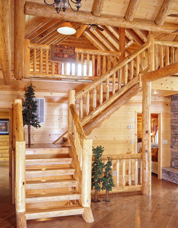 this l shaped log home staircase has a more rustic feel with the
