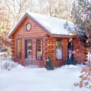 log home cabin with big windows
