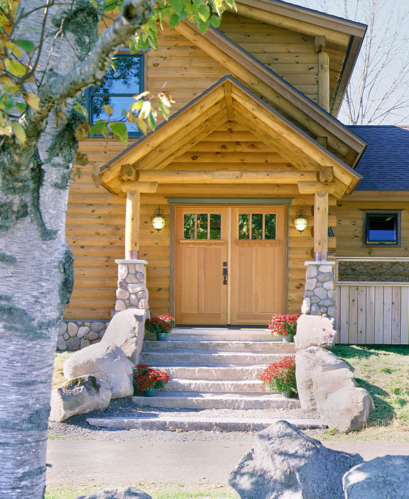 log home with double front doors in craftsman style
