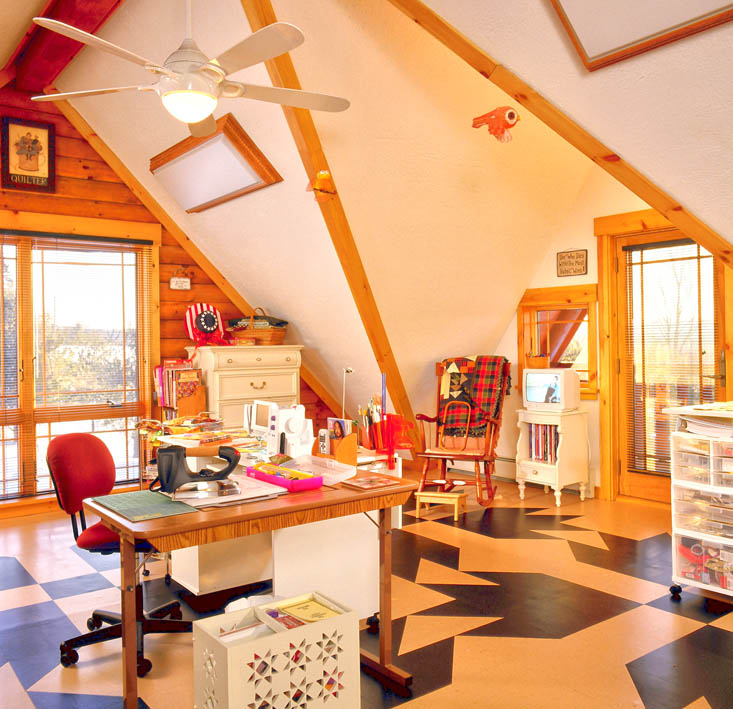 Quilting room in log home with quilt pattern floor