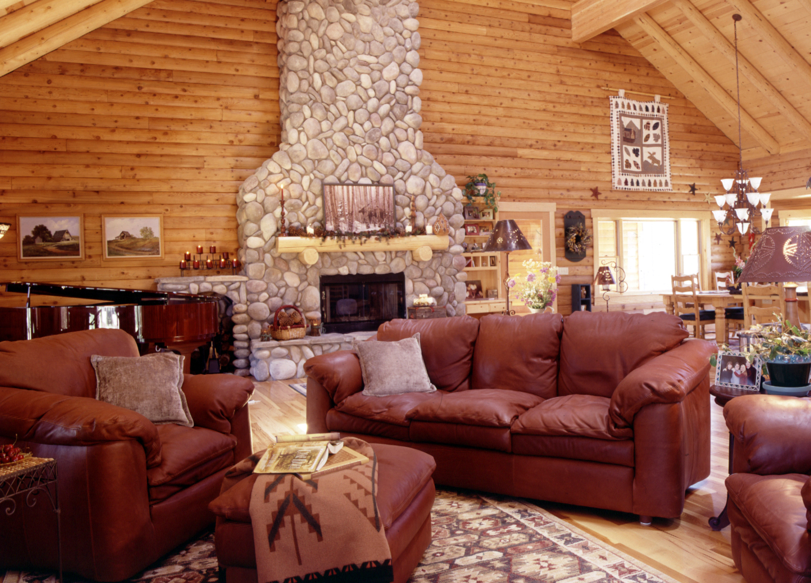 log home great room with leather sofa