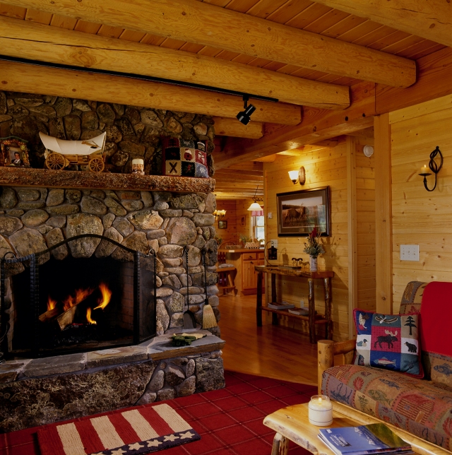 Celebrate the romance of a log home or cabin this winter for Log cabin fireplaces pictures