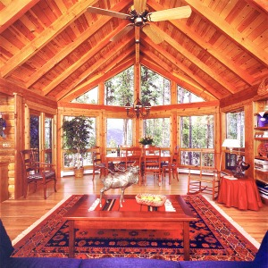 log home great room with prow wall of windows