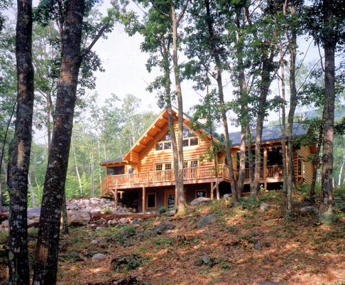 log home in the woods with porch