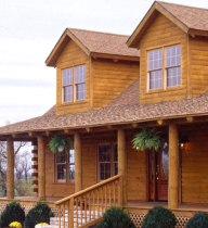 log home with dormers and front porch