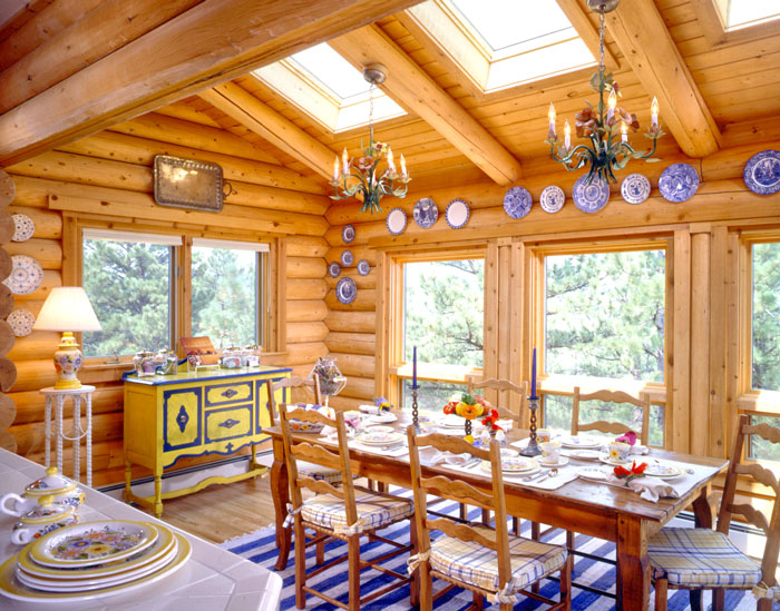 log home dining room with bright blue rug
