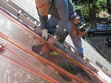 builder laying cooper roof