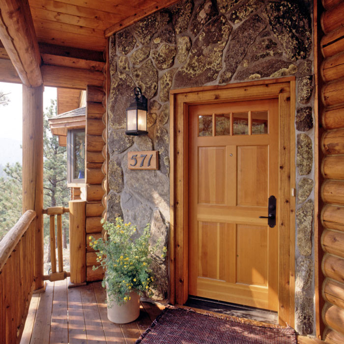 Log homes with stone real log style for Stone and log homes